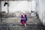 Frank Ward: Woman in a Market Stall, Khujand, Tajikistan, 2009